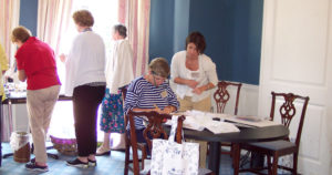guests at needlepoint workshop working on projects